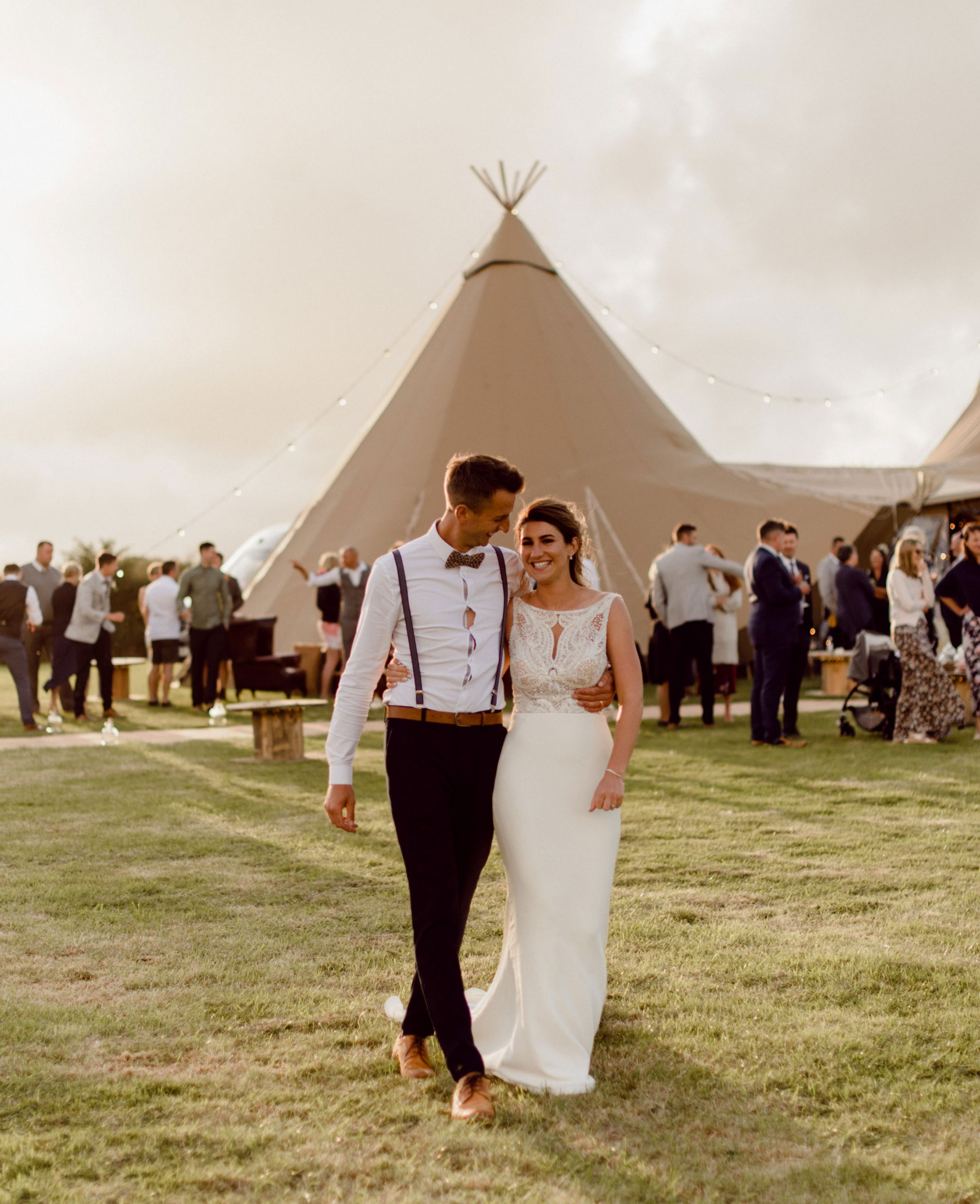 bride and groom outside tipi