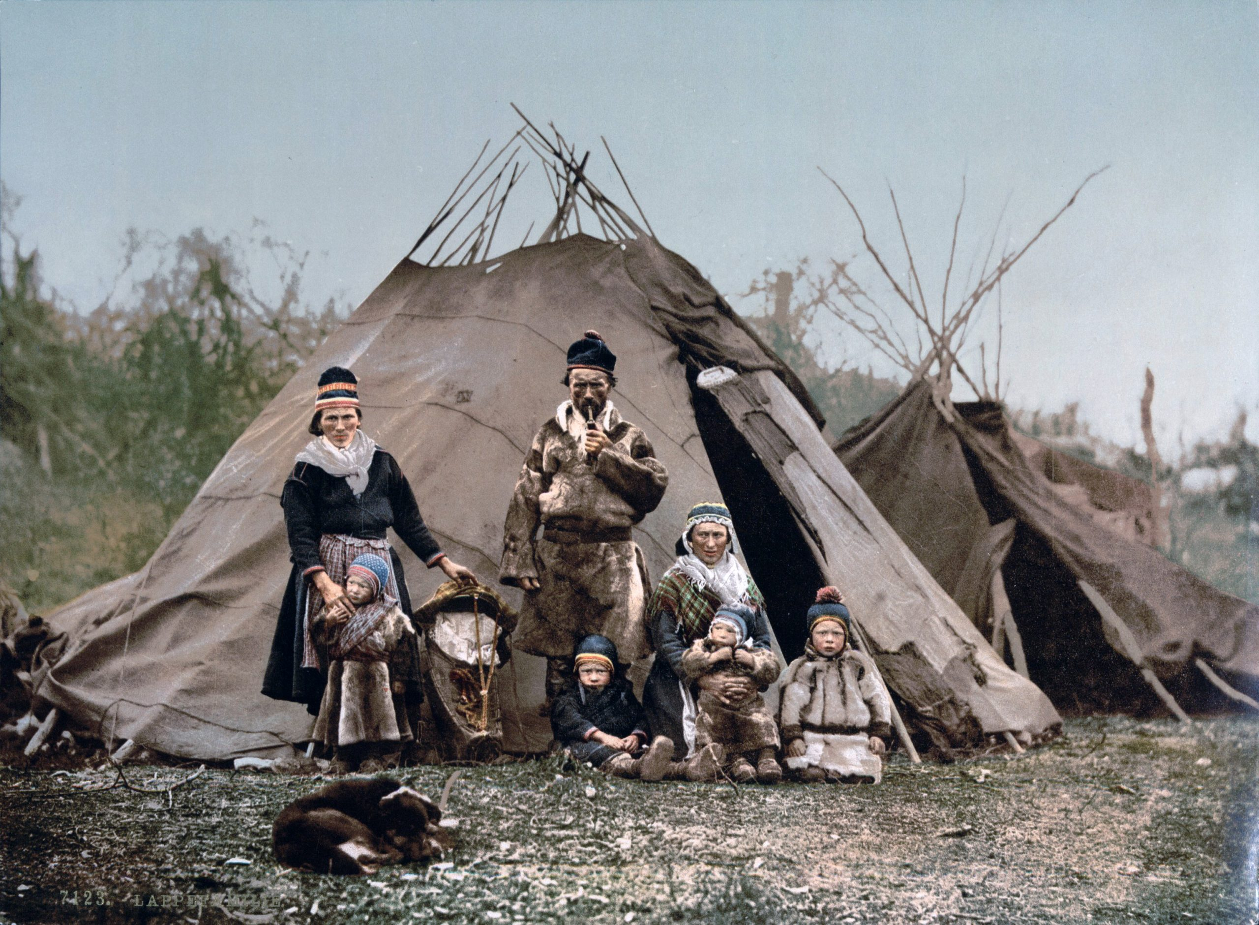 Sami people outside tipi home